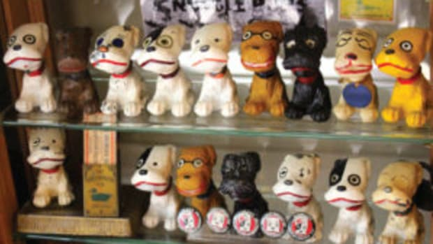 Joe Zawadowski's Snuggle Pup collection. At bottom left is a Snuggle Pup of unknown name, sitting alongside matchbooks by The Greenduck Co. of Chicago, manufacturers of the Snuggle Pups. Image courtesy of Mary Theisen