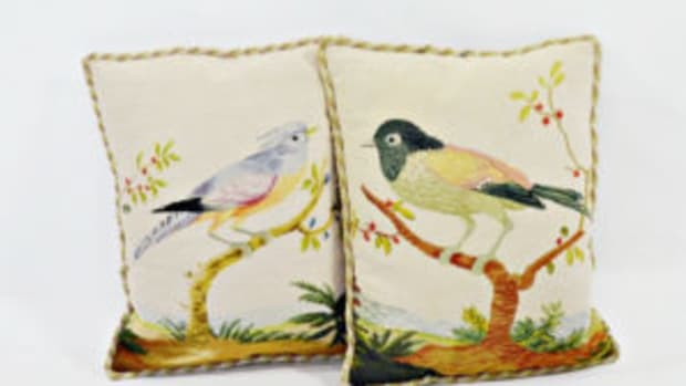 A pair of needlepoint pillows with bird designs, rope trim, dark tan cotton backing and a wool, needlepoint front with two different birds perched on branches. Includes two pillow inserts. $1,050.