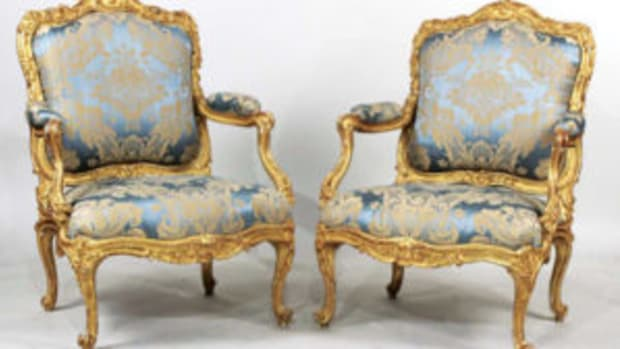Pair of Louis XV giltwood fauteuils à lareine, made in France circa 1755-1760 by Jean Gourdin, $225,000.