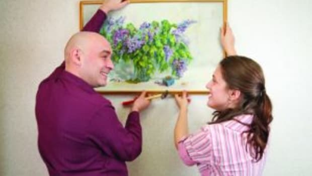 Couple hanging artwork