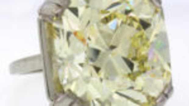 This rare 34.28 carat Old Mine Cut fancy light yellow diamond and platinum ring from the historic Spenger Collection sold for $530,000.