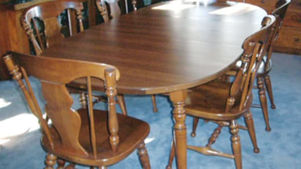 This table, while it seems to match the Heywood-Wakefield chairs and hutch, was actually made by Tell City of Tell City, Ind.
