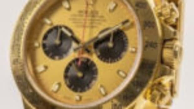 Lot 1 in the sale is a Rolex wristwatch: Rolex Cosmograph Daytona in 18K yellow gold, model 116528, 39mm case, serial no. D446753