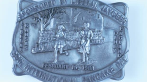 "1988 39th International Pancake Day buckle depicts the Pancake Day race held in both Liberal, Kansas and Olney, England on February 16, 1988. The back of the buckle shows it was designed by ""Western Associates Inc of Marion, Kansas."" Limited Edition, No. 124 of 500. ($15, May 2017)"
