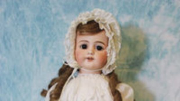 Standing view of Edison Phonograph Doll with its original outfit and shoes. Dress and bonnet are delicately trimmed with lace. Author's Collection.