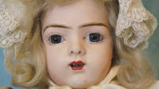 One of the original papier mâché Bru twins, glass eyes, mob cap. From the author's collection.