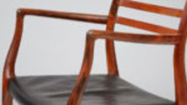 "Rosewood ""Model 62"" armchair, restored with original, patinated black leather seat, Niels Moller for J.L. Moller Mobelfabrik, Denmark, 1962, 22"" x 31.5"" x 21.6"", $4,741. Courtesy Design Market, www.design-mkt.com"