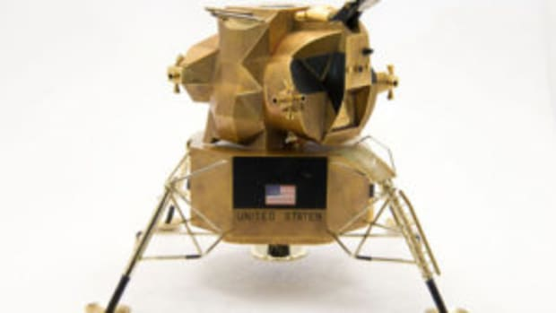 Gold lunar module replica