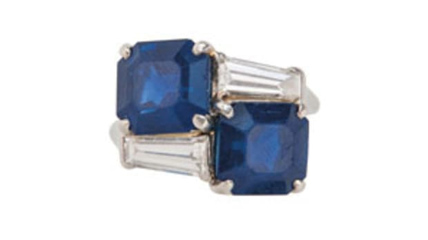 An important sapphire and diamond ring, Cartier, c. 1950s, set with two square-cut sapphires measuring approx. 9.21 x 8.64 x 6.55 and 9.27 x 8.75 x 6.05 mm, in a platinum and diamond mount set with tapered baguette-cut diamonds, size 5 3/4, numbered, signed. Estimate $300,000-$500,000. Images courtesy of Skinner Auctioneers and Appraisers
