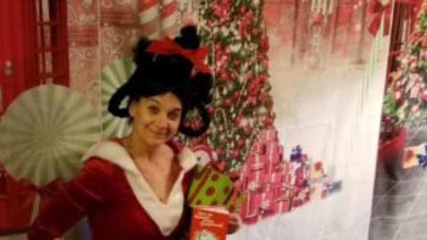 "SherieLee Schnell dressed up as Little Cindy Lou Who when Marshmallow World's theme was ""A Whoville Christmas."""