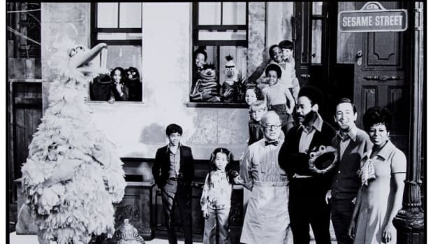 "Debuting in 1969, this rare image depicts the full cast of the first season of Sesame Street and is signed by Carroll Spinney (Big Bird). Featured are Big Bird (rookie photo), Mr. Hooper (Will Lee), Gordon (Matt Robinson), Bob (Bob McGrath), and Susan Robinson (Bob's wife). The rest of the Muppets include Cookie Monster, Grover, Ernie & Burt, and Oscar the Grouch. These were the only Muppets featured in the first season. The iconic ""Sesame Street"" sign can be seen in the upper right corner. Spinney signed this historic image in mint blue sharpie and added his trademarked red dot, $34. Courtesy of Heritage Auctions"