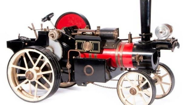Vintage Model Steam Engine. 12 inches high x 19 x 8 1/2. Estimate: $300-500.