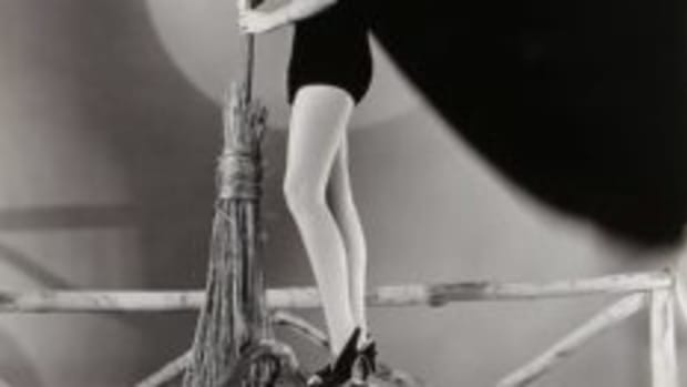 In this pinup photo for Universal in 1939-1940, the witch-dressed starlet standing on the pumpkin is Helen Parrish. She got her start in movies at age 2 in 1927, playing the daughter of Babe Ruth in Babe Comes Home.