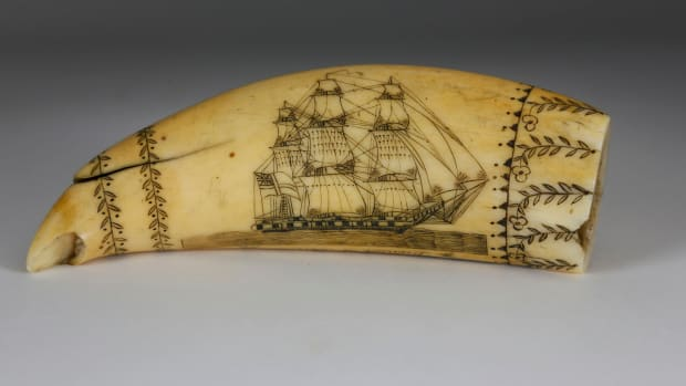 "Scrimshaw whale tooth, Daniel of London by the Britannia engraver, first half of the 19th century, titled along the edge ""Daniel of London,"" obverse depicts a starboard portrait of the Daniel in full sail; the verso engraved with the Daniel half engulfed in fire and rigging breaking free, all within four wrap-around borders; 5-1/2"" l, 2"" w. Estimate: $10,000-$12,000."