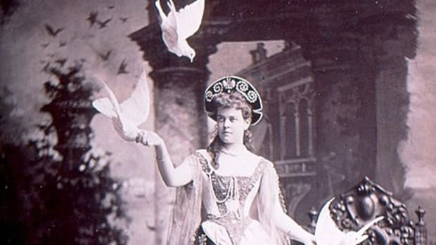 "Alva Vanderbilt at her official opening of the chateau in March 1883, in her costume of a ""Venetian Renaissance Lady."" The photographer apparently added the birds in later, for whatever reason."