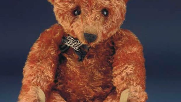 "This cinnamon-colored mohair center-seam bear, circa 1908, wearing a silver and paste brooch with the name ""Will,"" sold at Christie's in 2004 for $55,304. Although far from the most expensive bear ever sold, it is one of the rarest in the world and was owned by Pam Hebbs, who was considered to be one of the world's greatest antique teddy bear collectors and evaluators, and author of the 1998 book, Collecting Teddy Bears."