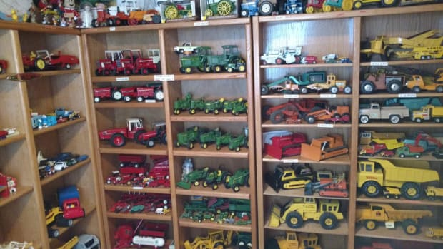 Dump trucks, farm tractors, bulldozers and plenty more vehicles line shelves in one of Ken Mueller's collection rooms.