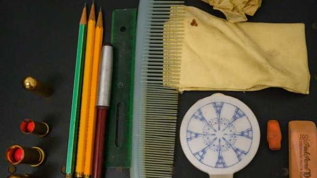 Various items that were in Patti's purse including lipstick, a ruler, comb, pencils and erasers.