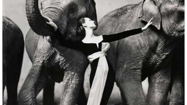 "The most iconic fashion photograph of all time: Richard Avedon's ""Dovima with Elephants,"" 1955, Cirque d'Hiver, Paris, featuring Domvina wearing an evening gown by Dior and posing with elephants; number ten from an edition of fifty; $615,000."