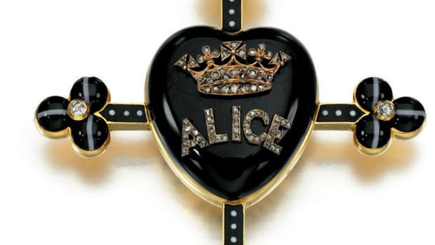 One of Queen Victoria's mourning pieces honoring her daughter, Alice: onyx, banded agate, enamel and diamond pendant circa 1878, centering on an onyx heart with Alice beneath a coronet, and a glazed compartment containing a lock of hair, shown below. This sold at auction for $34,821.