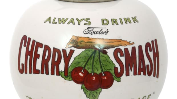 """Fowler's Cherry Smash syrup dispenser, early 20th century, with the original pump, inscribed """"Property of John E. Fowler, Richmond, VA, To Be Used for Cherry Smash Only,"""" 15"""" h; est: $1,500-$2,500."""