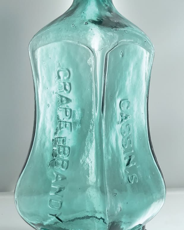 A 150-year-old blue Cassin's Grape Brandy Bitters bottle, so rare that for years many doubted its existence, has sold for a staggering $155,000.