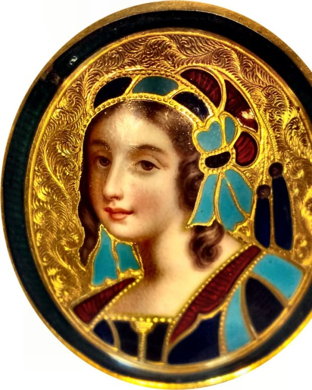 """Basse-Taille means """"low cut"""" and refers to the enamel-filled, relief-work in the base metal, which is usually silver or gold as in this 18kt gold, Basse-Taille brooch."""