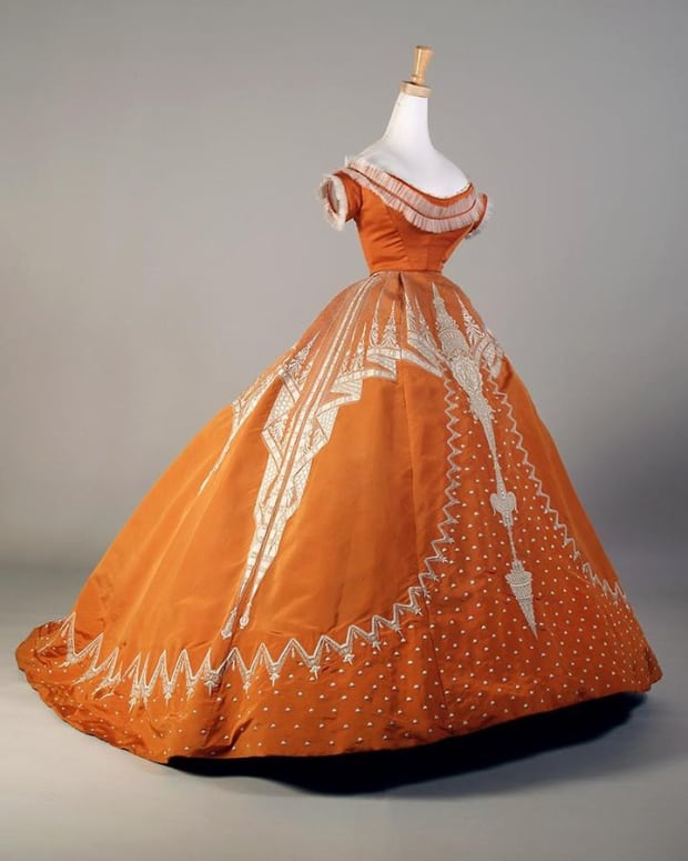 Orange evening dress with white embroidery, French, ca. 1865-67, by Charles Frederick Worth.