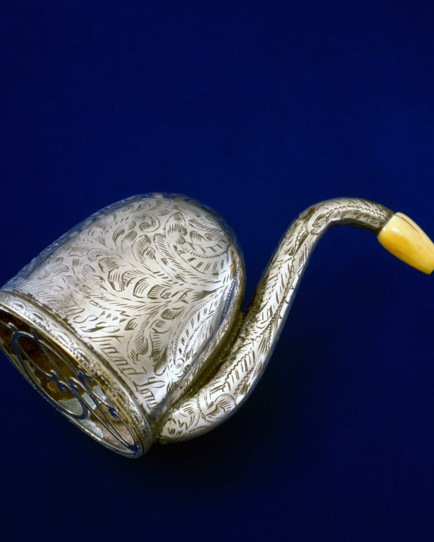 Swan-shaped ear trumpet made of brass, with an ivory earpiece, made by F C Rein and Son, London, circa 1865.