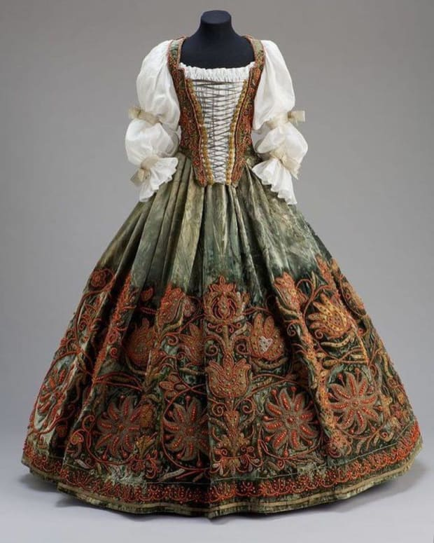 A Hungarian costume featuring a cambric blouse and velvet skirt, mid-17th century.