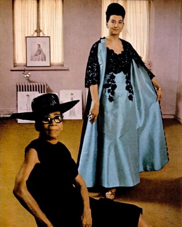 Ann Lowe, at 67, in her New York atelier, with a model posing in her one of her designs in Ebony Magazine, 1966. Every dress Lowe designed was hand-sewn and one-of- a- kind, tailor made to fit the wearer's exact measurements. Her superb work and attention to found an audience among New York City's most affluent social circles.