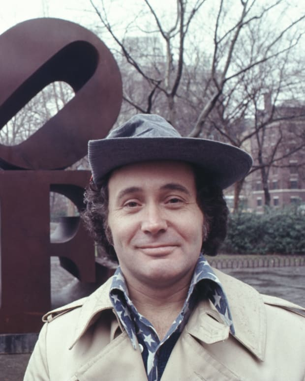 Robert Indiana with his LOVE sculpture in New York's Central Park in 1971.