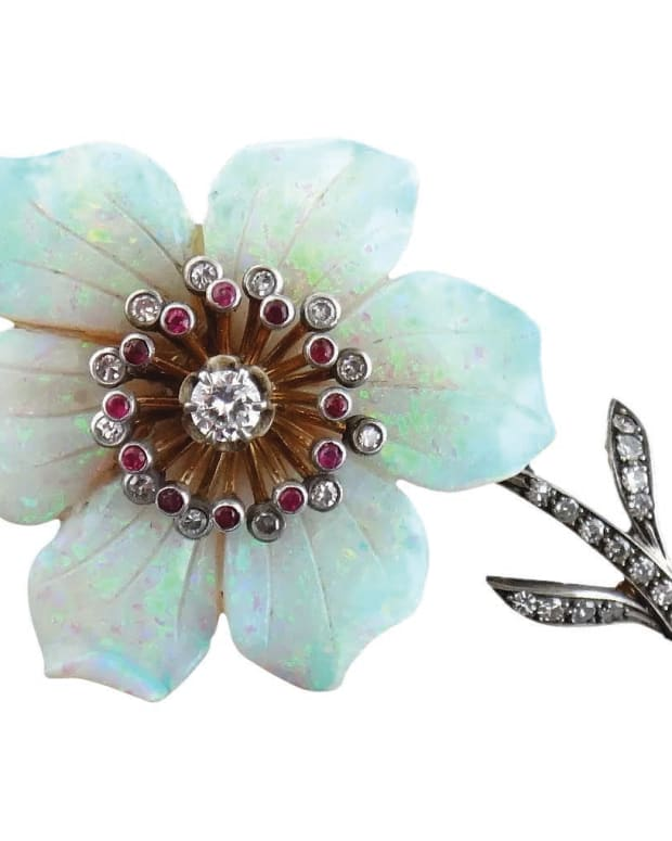 An enchanting six-petal opal flower displays flashes of electric blues, greens and magenta pinks; 18k gold and silver, with full and single-cut diamonds and rubies; $2,700. Courtesy of Syosset Antiques: rubylane.com/shop/jewelmanity