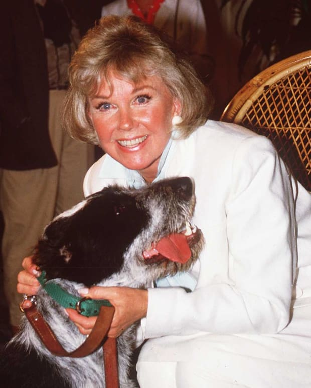 "Doris Day loved animals. She once said, ""They give us unconditional love and ask very little in return. I've never met an animal I didn't like, and I can't say the same thing about people."" Here she is in 1985 with one of her beloved dogs."