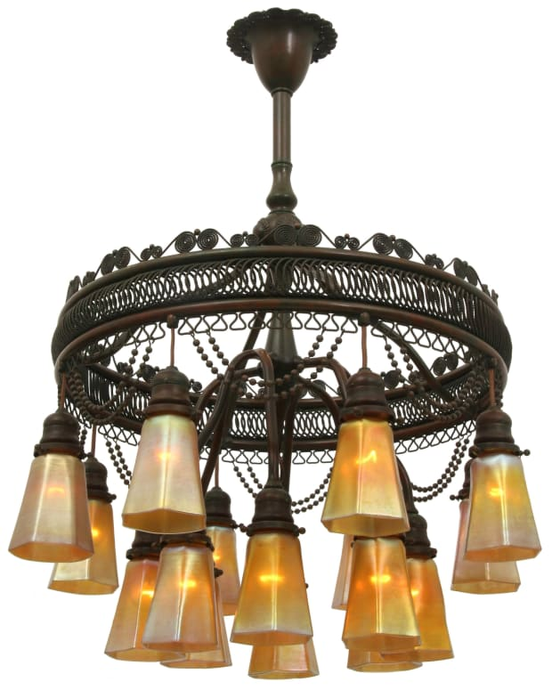 "Among the Day 1 highlights on May 22 is this Tiffany Studios ""Moorish"" chandelier, circa 1905, patinated bronze, Favrile glass, 16 shades are engraved ""L.C.T.,"" 34-1/2"" x 24""; estimate: $40,000-$60,000."