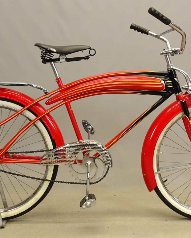 """C. 1937 Dayton Huffman """"Super Streamliner"""" balloon tire Airflow bicycle, featuring twin Delta Silver Ray Lead lamps, 3 rib long horn tank, Mesinger B Deluxe saddle, Persons tear drop pedals. Est: $1,500-$2,500."""