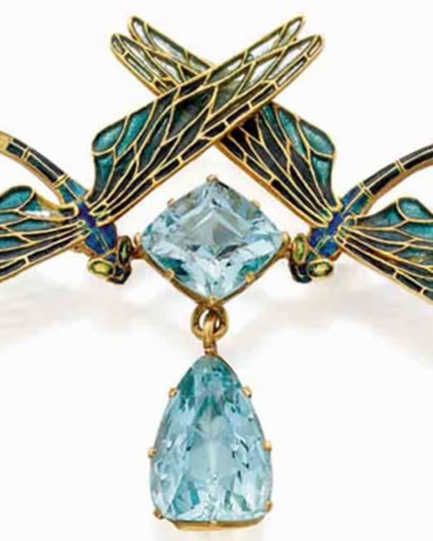 """Lalique's """"deux libellules"""" brooch in the form of two facing dragonflies in gold, plique-a-jour enamel, and aquamarines, c. 1903, 2-1/2"""" w; $75,600."""