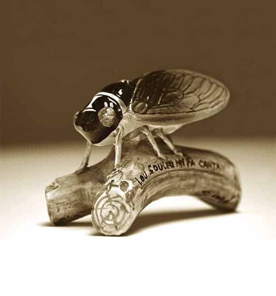 Louis Sicard's earthenware paperweight with a cicada resting on an olive branch, 1895.