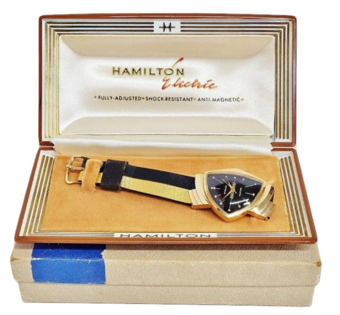A 14k gold Hamilton Ventura electric watch with original band  designed by Richard Arbib, and with original case; estimate: $3,000-$5,000.