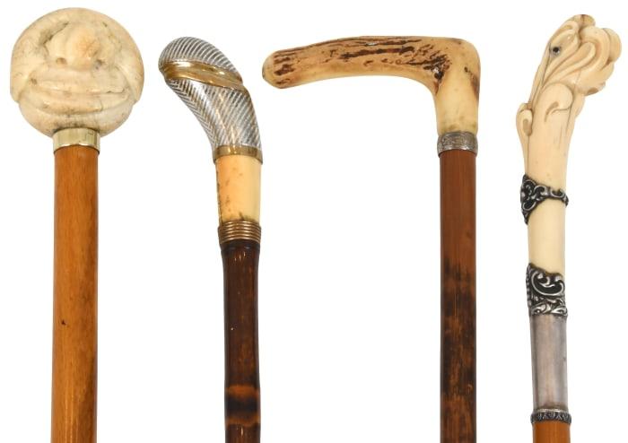 "Group of four walking sticks,  longest is 38-1/2""; est: $300-$500."