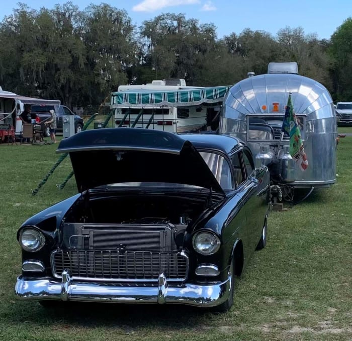 A 1957 Airstream owned by Roger and Bev Reger of Lakeland, Florida, is staged with the Regers' 1955 Chevrolet 150 Business Coupe. Many vintage trailer owners are also into vintage automobiles.