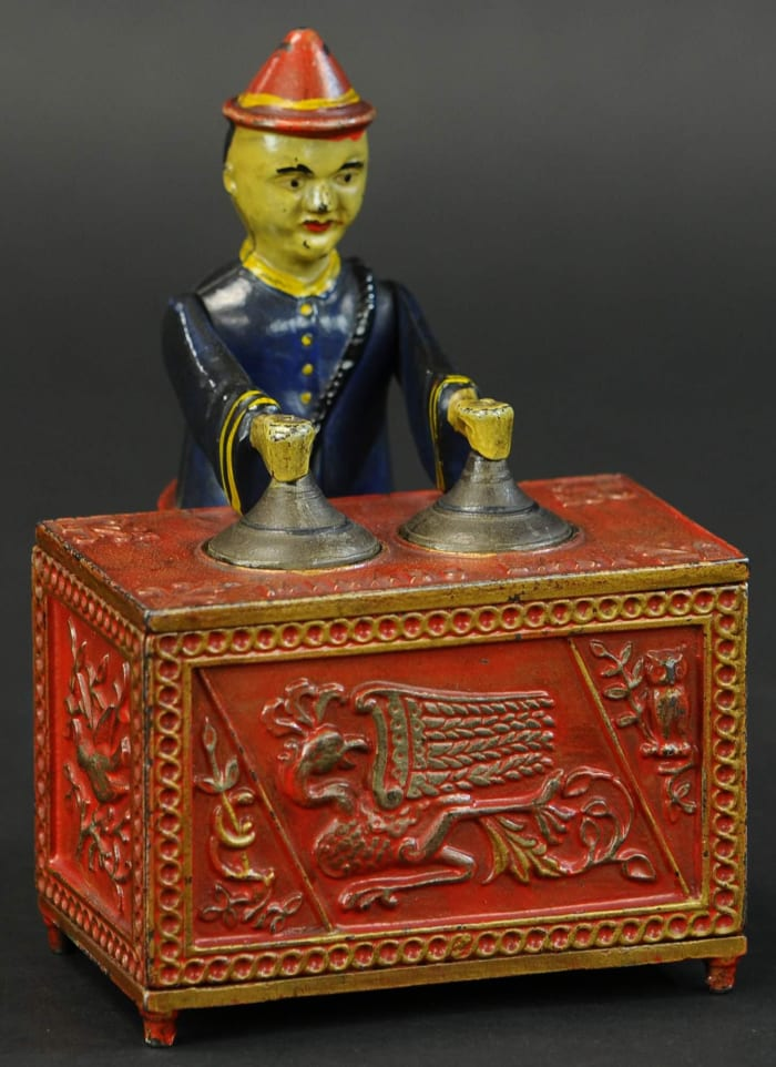Kyser & Rex Co. Mikado cast-iron mechanical bank, red-table version, extremely rare and one of the best examples known. Estimate: $80,000-$120,000.