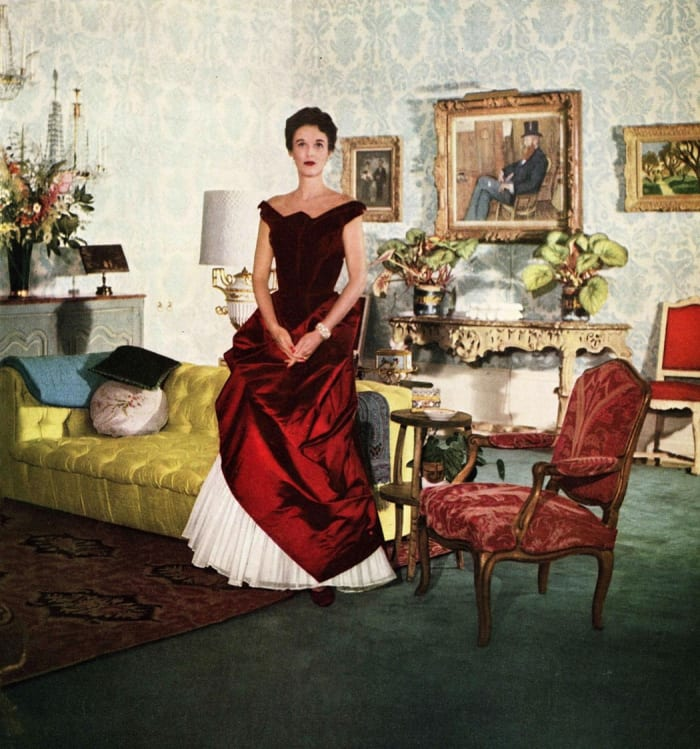 Socialite Babe Paley wearing a crimson James' ball gown, 1950.