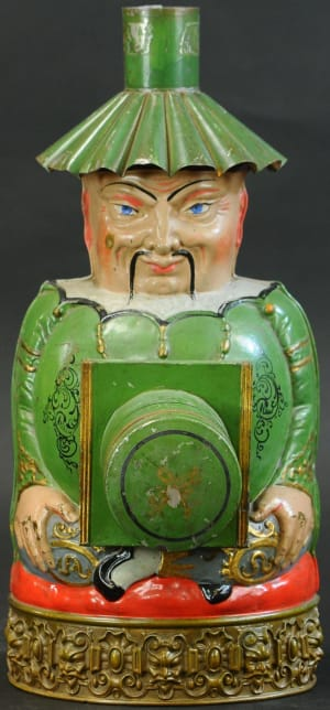 """Chinaman Magic Lantern, French, circa 1870, was the top lot on day two of the sale, bringing $38,000. The figure, also referred to as """"Buddha,"""" is hand painted with a brass edged border that has gargoyle motif. It is extremely rare and the most desirable of all magic lanterns; 16-1/2"""" h."""