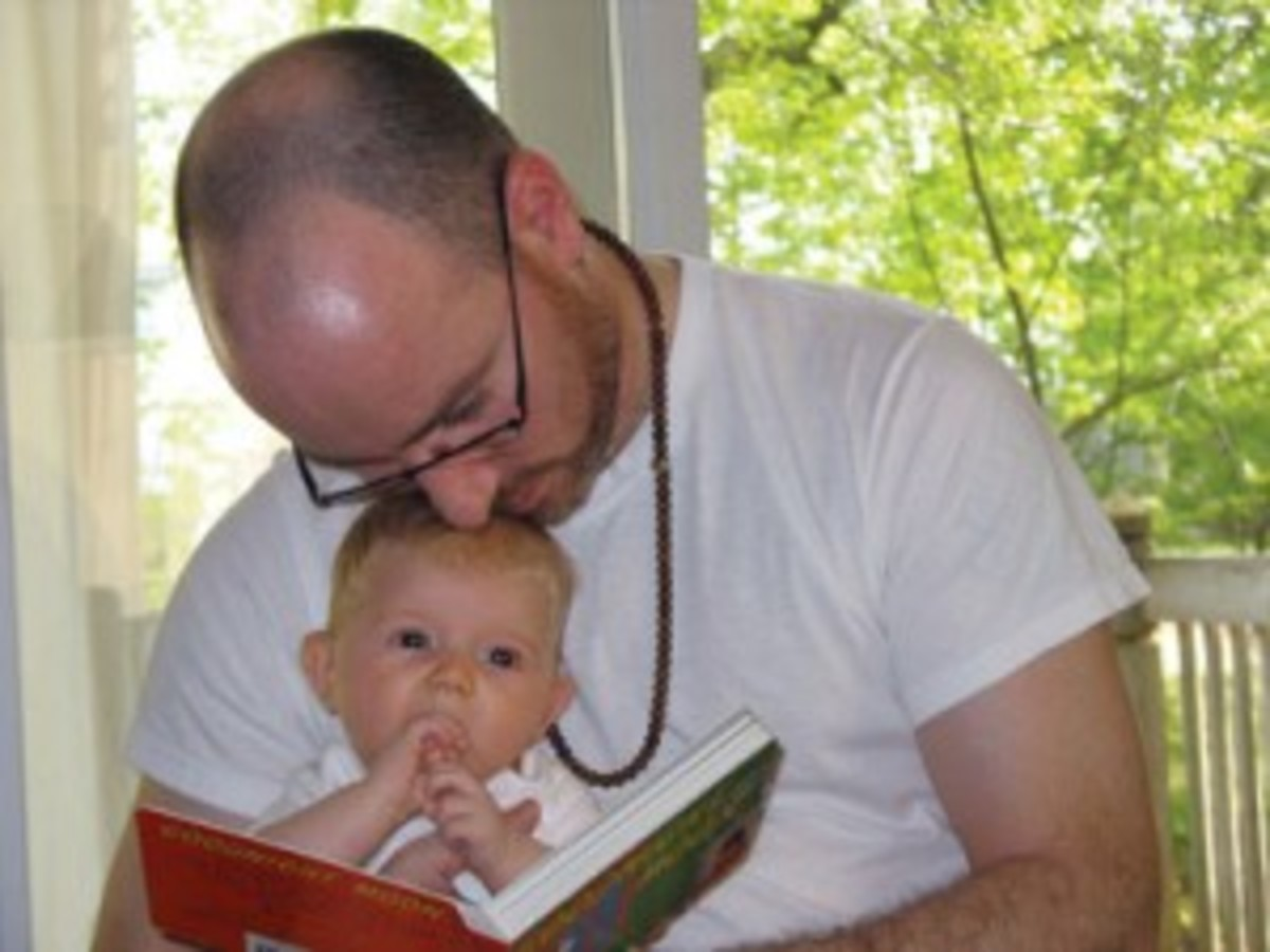 "Co-author Noah Fleisher with his then baby daughter, Fiona. (All photos featured in ""Collecting Children's Books"")."