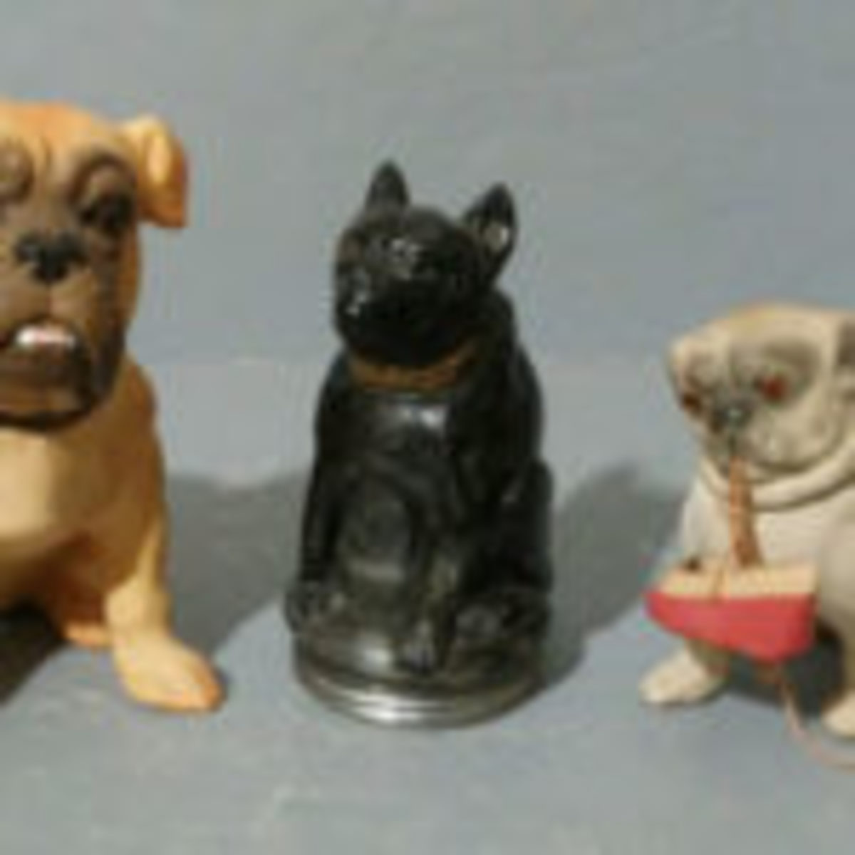 Even 100 years ago, everyone loved dogs! Animals were very popular subjects for candy containers. (Jackie Kojis Collection)