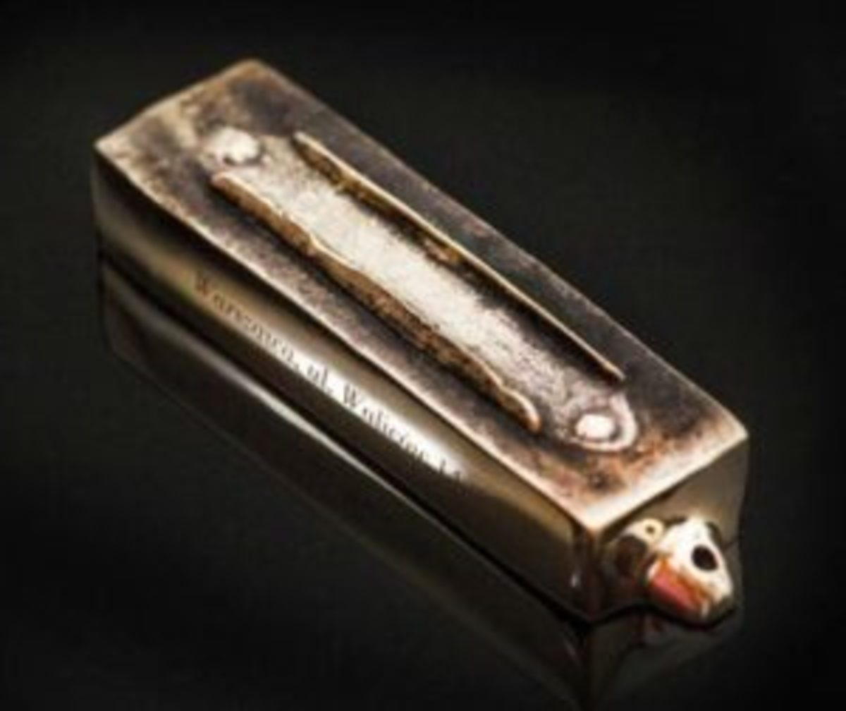 "Mezuzah created from Polish WWII-plundered niche at Warszawa, Ul. Walicow 14, ""Mezuzah from This Home"" series, bronze, 4 1/3"" long, available at Mi Polin, https://mipolin.pl."
