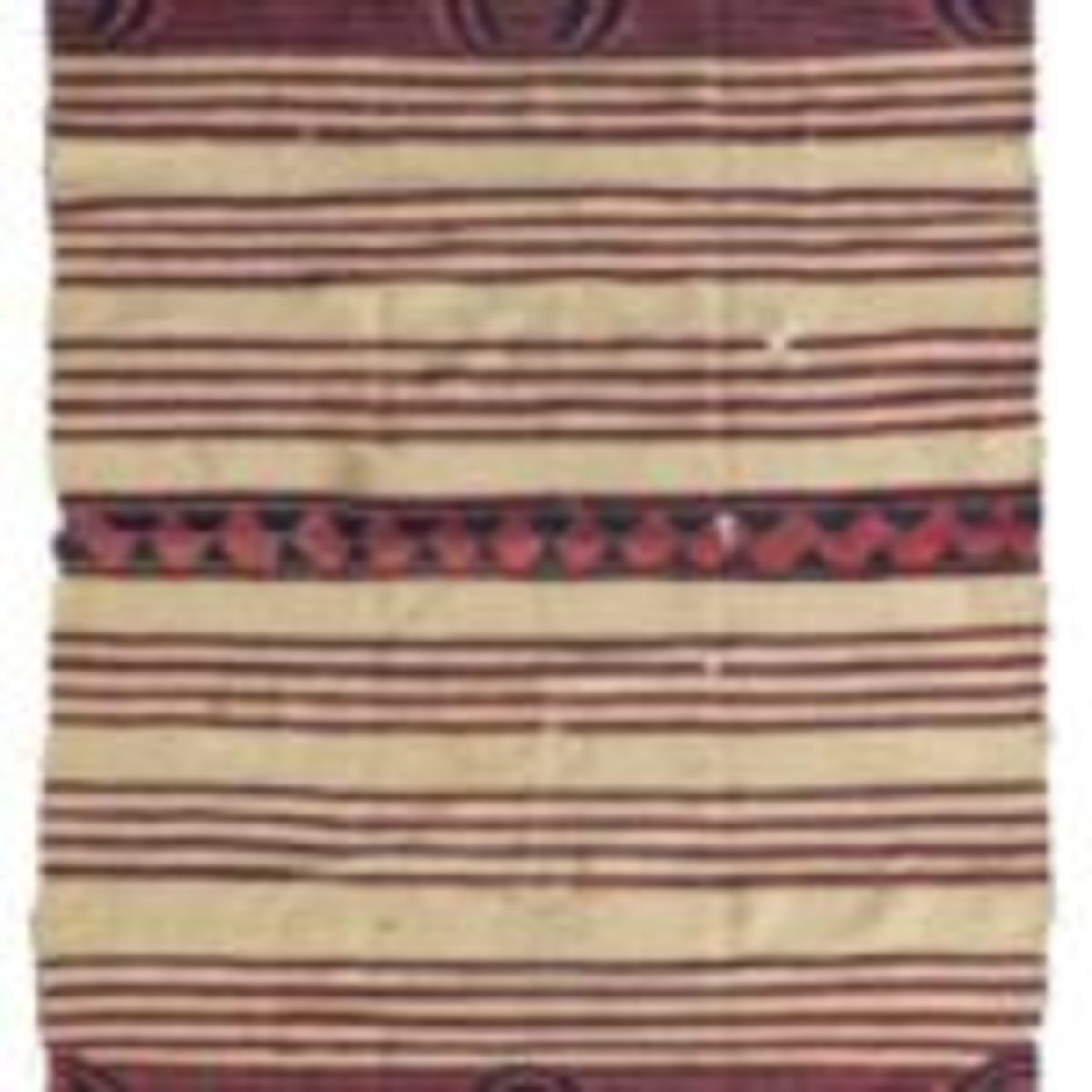 A Navajo classic period child's wearing blanket, mid-19th century, cochineal and indigo dyes, $93,750.