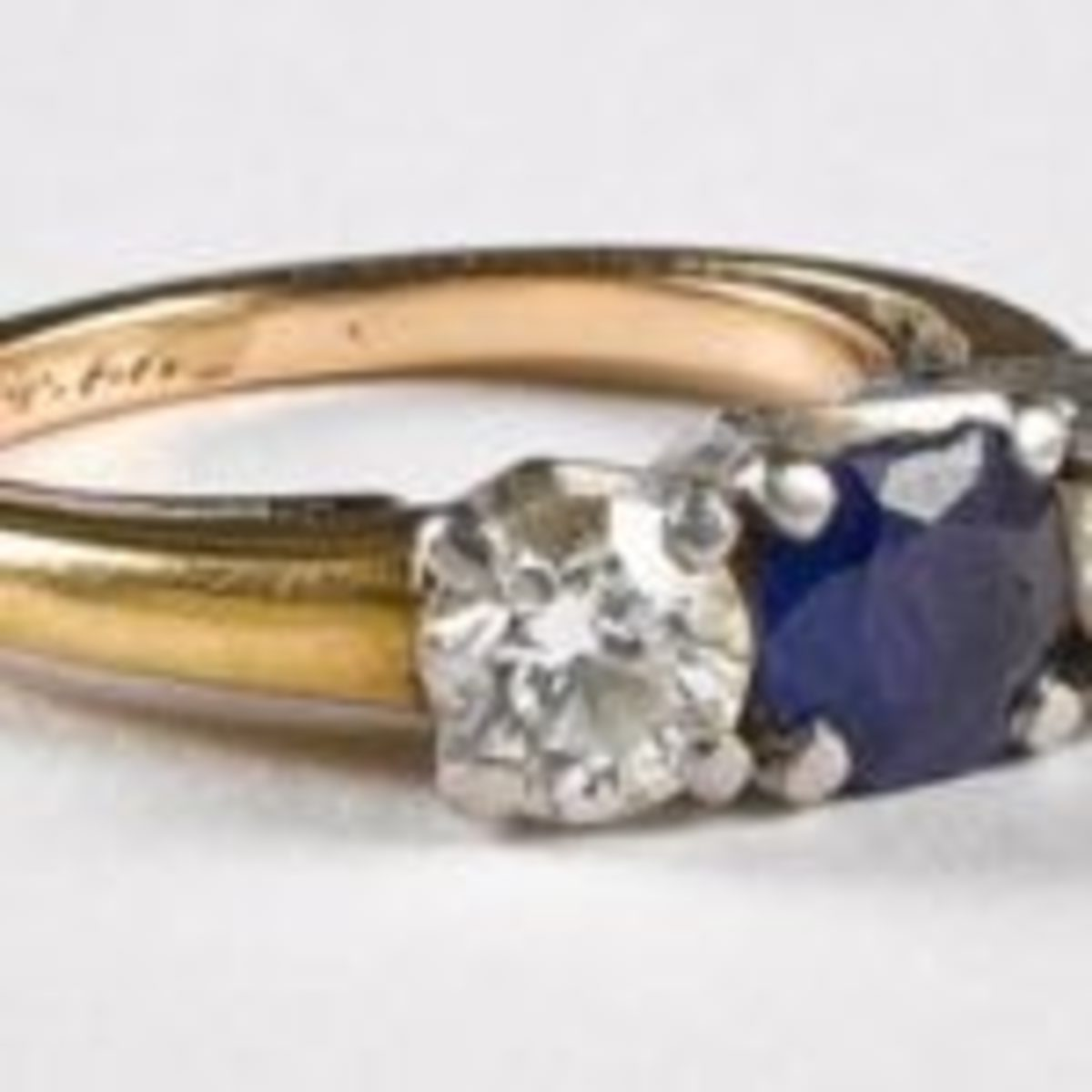 14K gold, diamond and sapphire ring. ($240-$280)