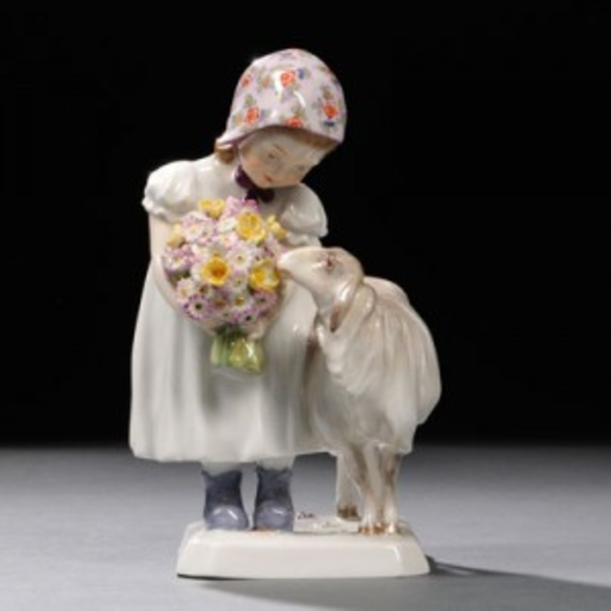 Porcelain girl with sheep
